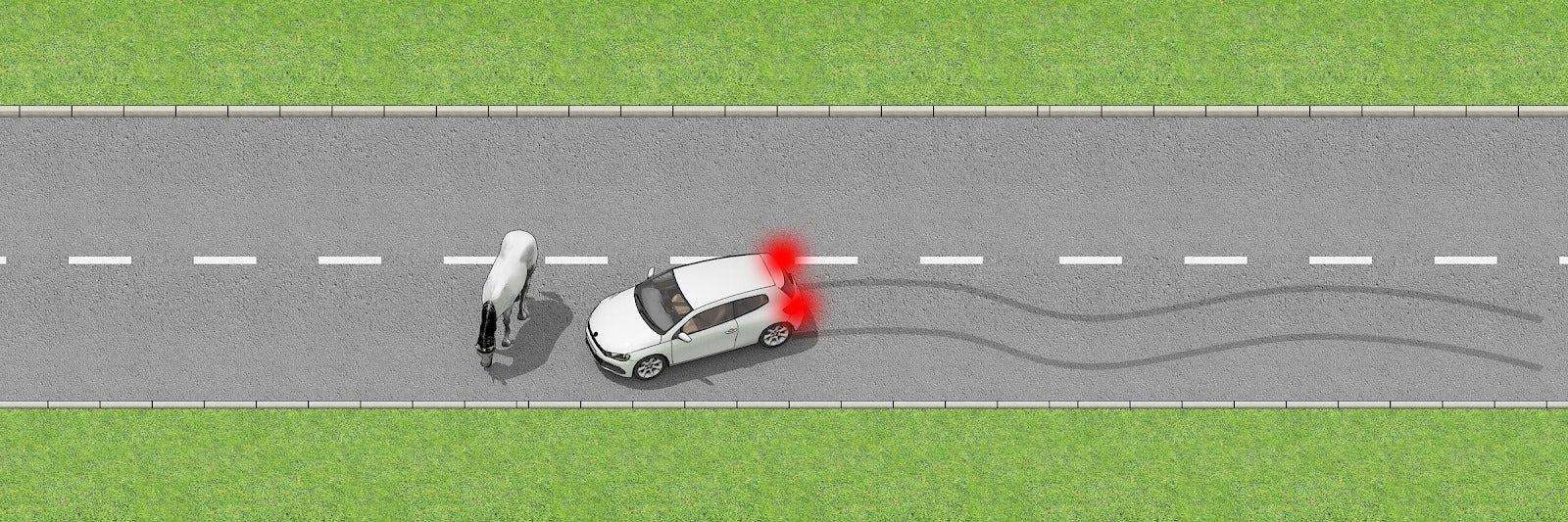A CAR BRAKING FOR HAZARD ON ROAD