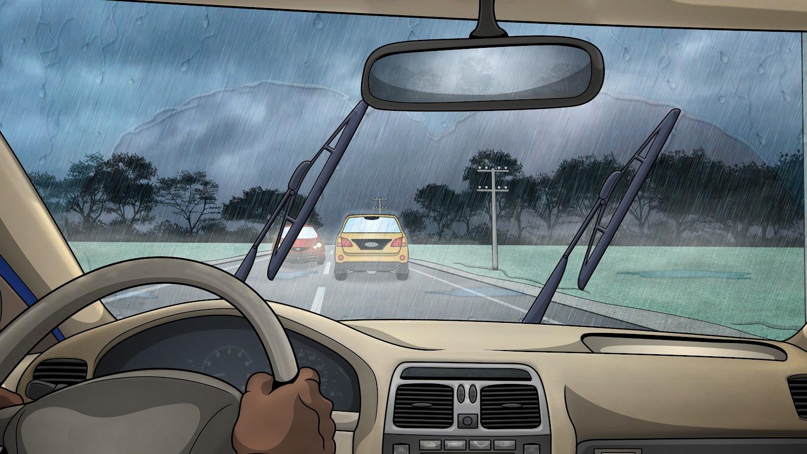 Det regnar på vindrutan på en bil som håller ett gott avstånd till bilen framför.